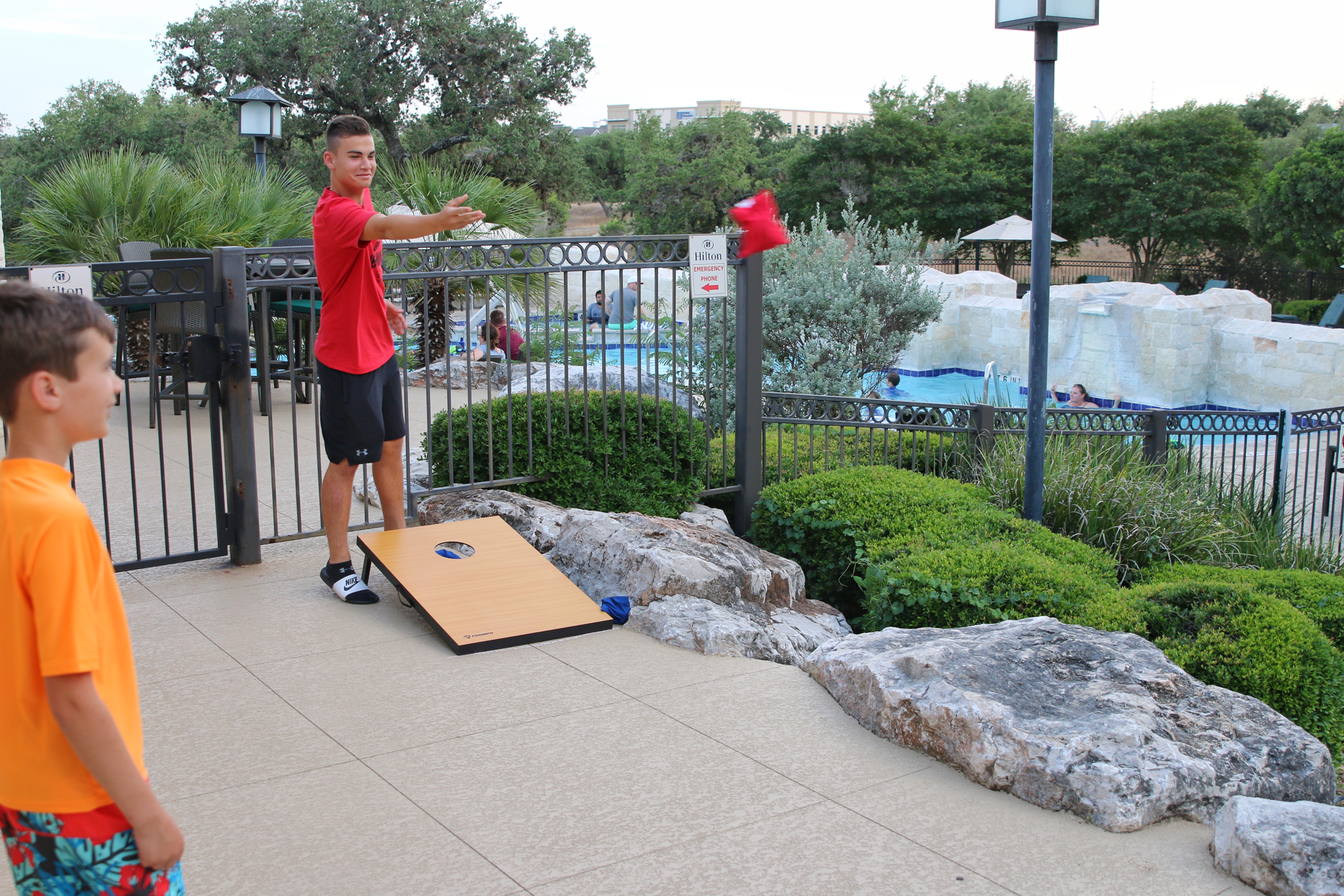 play corn hole at Hilton hotel