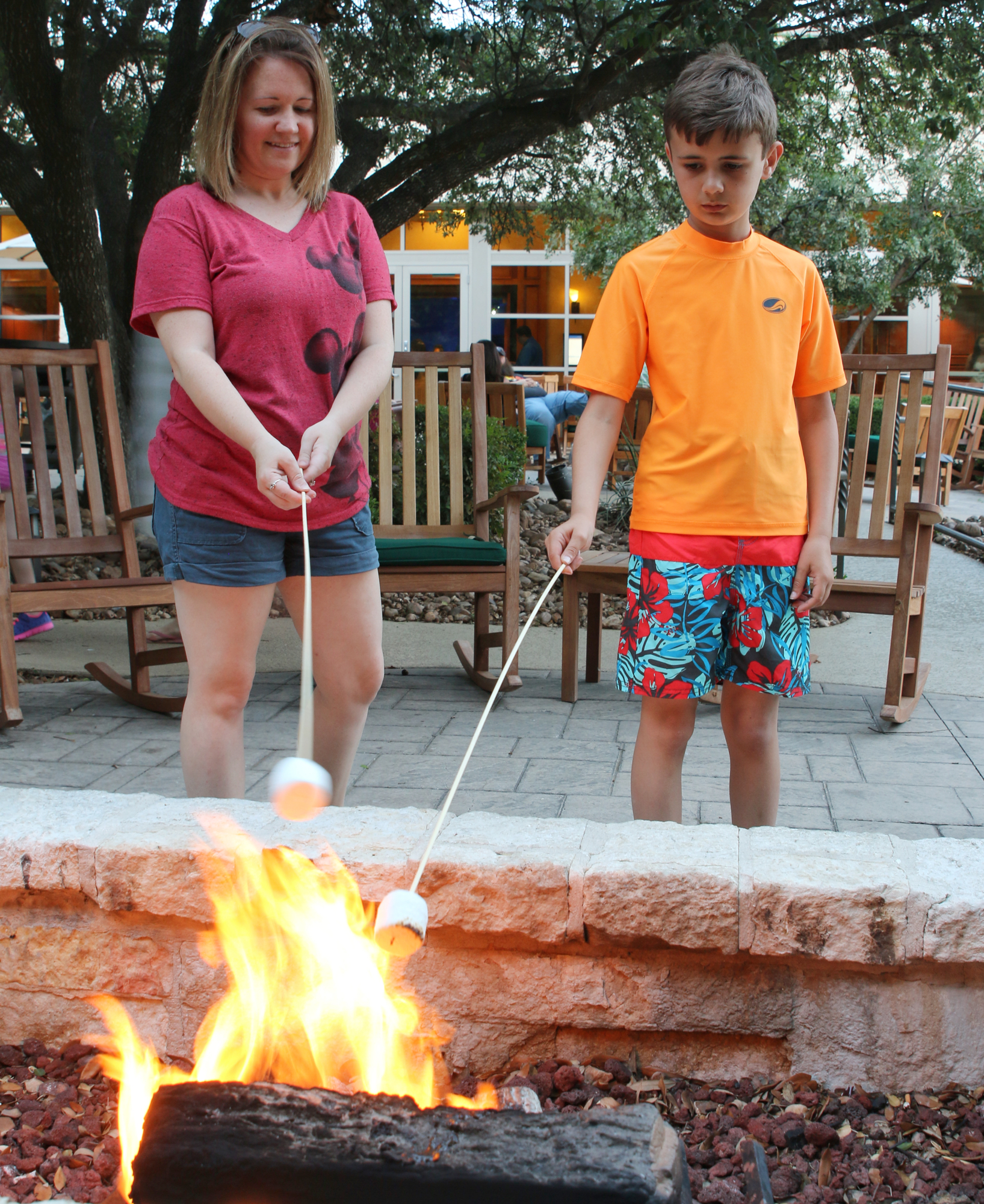 family making s'mores outside at Hilton hotel in san antonio