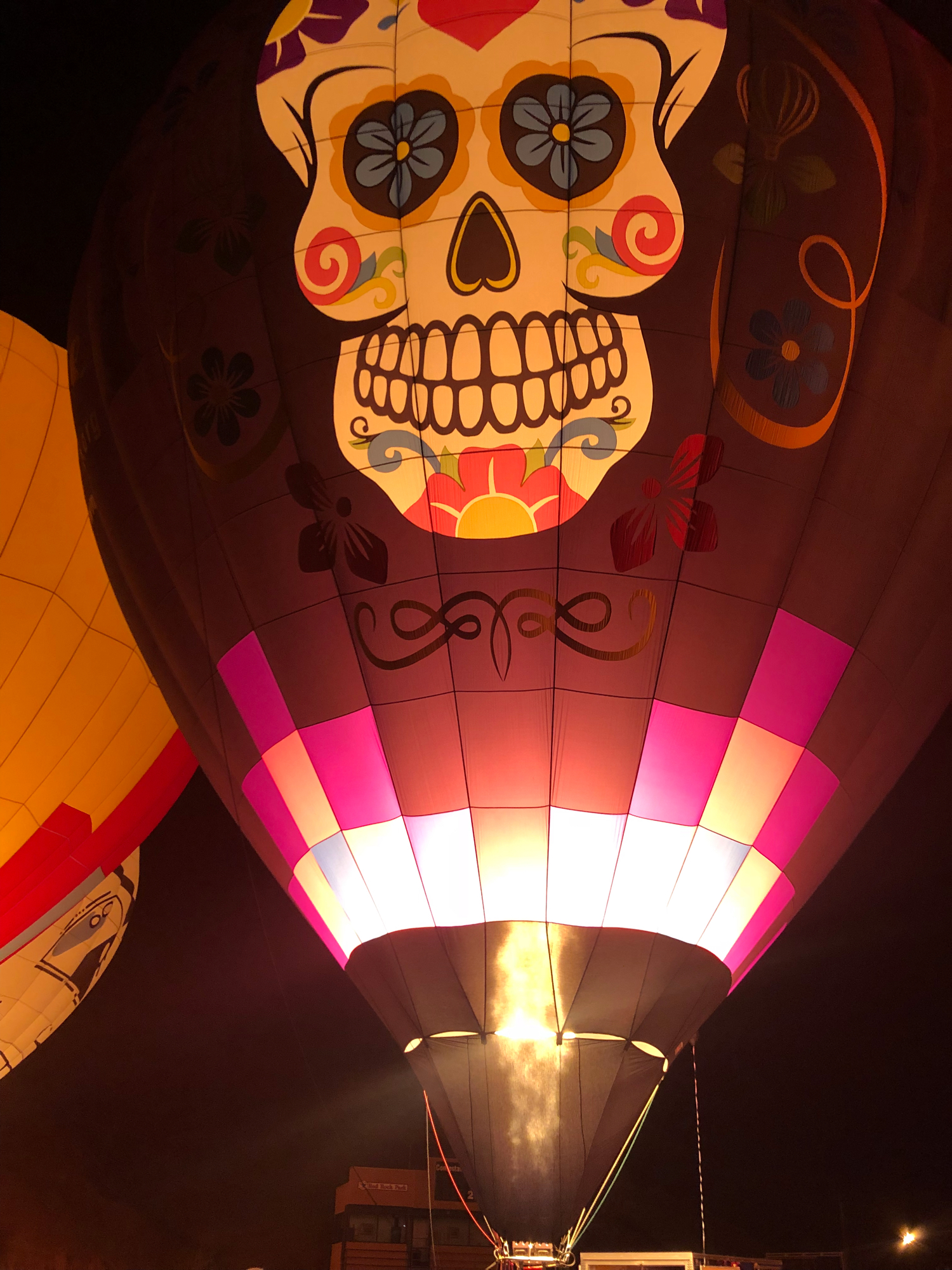 sugar skull hot air balloon glowing at night