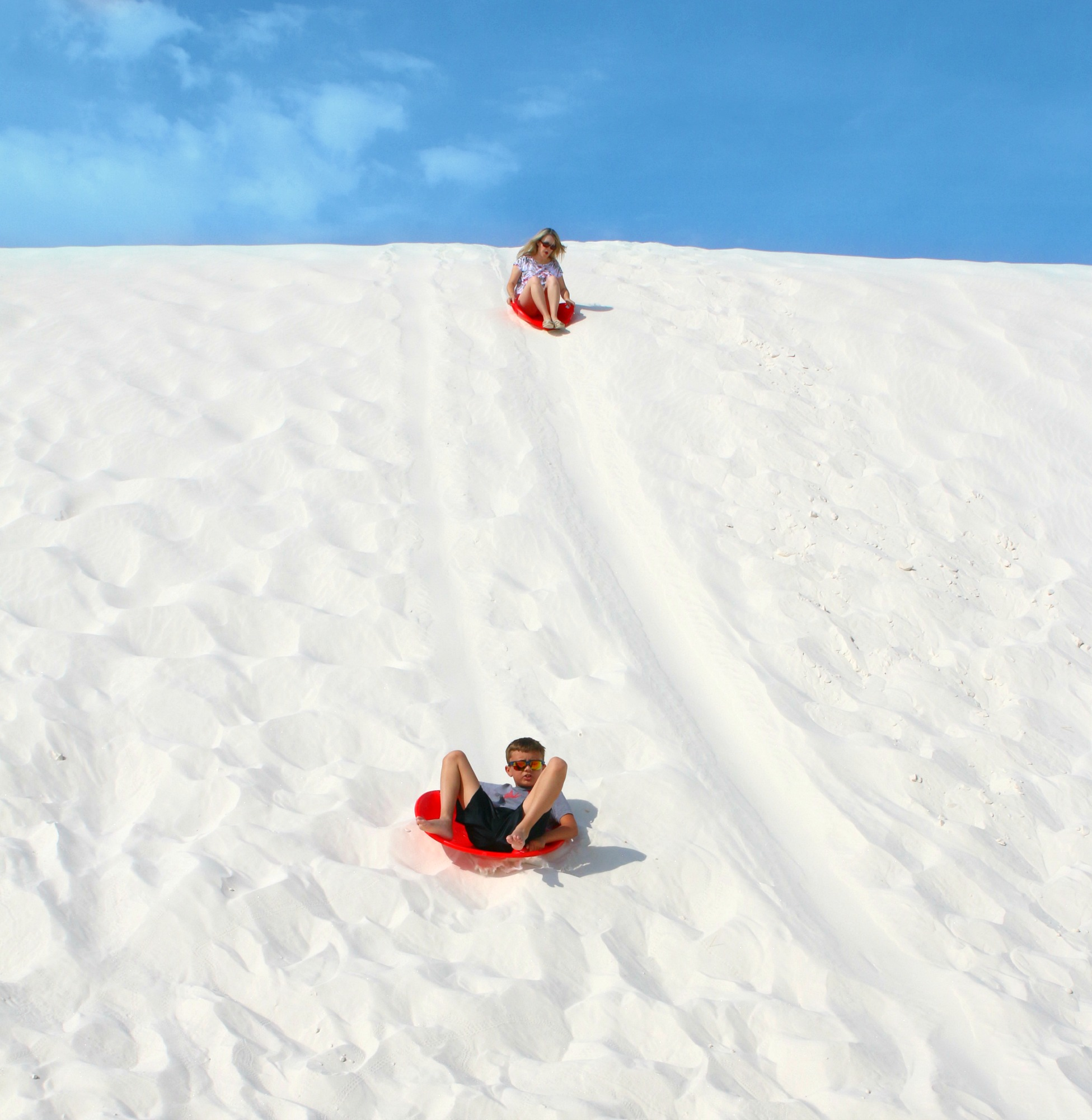 Noah sledding in White Sands