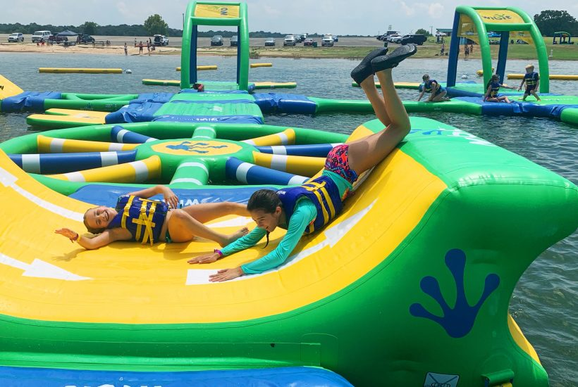 kids having fun on water inflatable